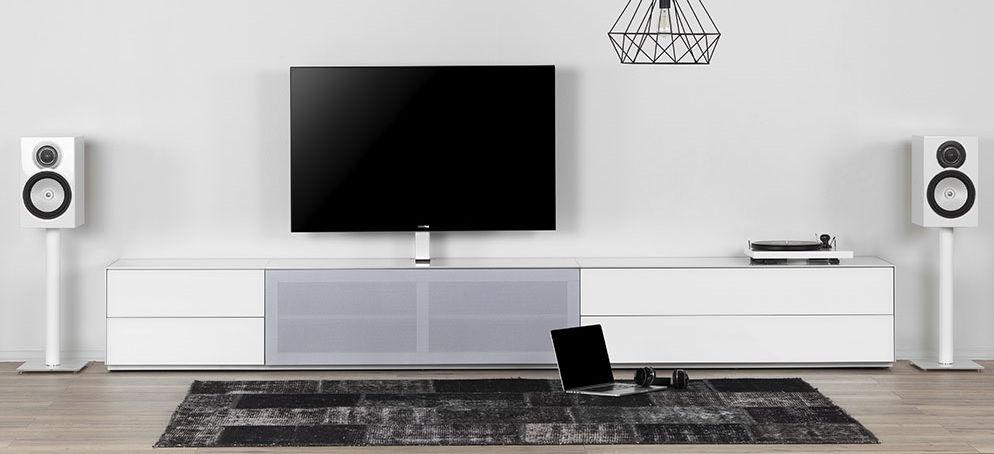 Тумбы для телевизора и акустическая ткань: в чем преимущества?